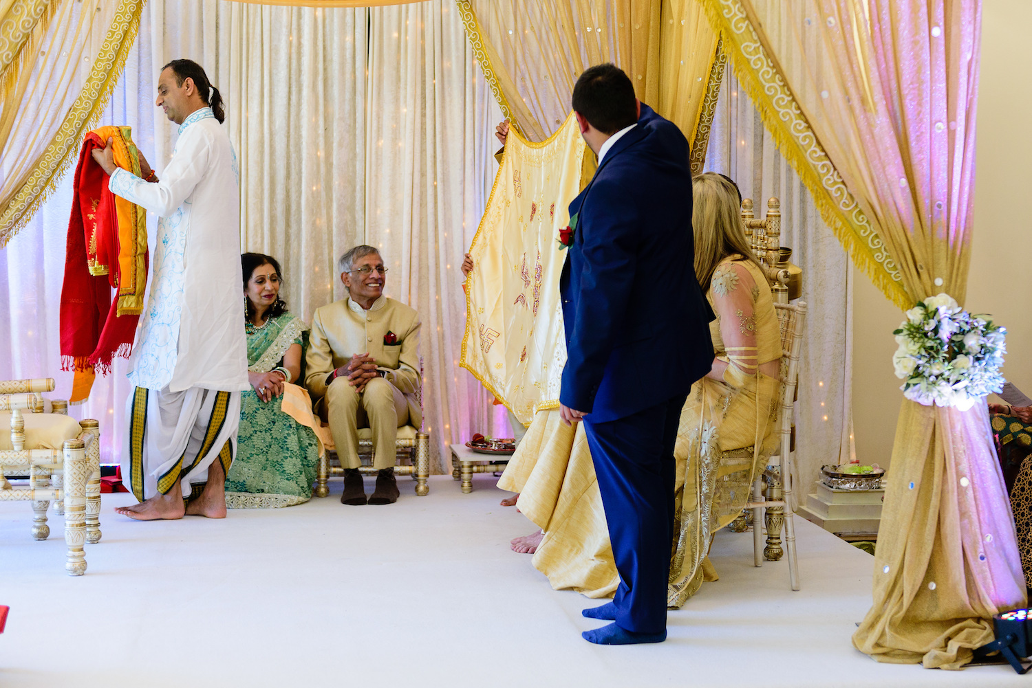 Wedding guests sit pre Indian wedding ceremony
